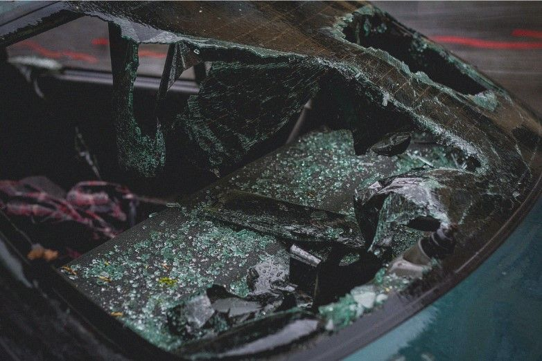 shattered car window after a car accident